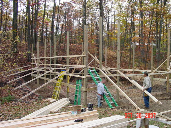 The next step is setting the poles and then the purlins that hold